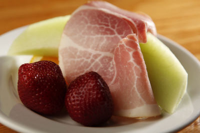 Seasonal melon with Black Forest ham & fresh berries